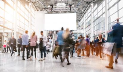 anonymous blurred people rushing at a trade fair - Stock Photo or Stock Video of rcfotostock | RC-Photo-Stock