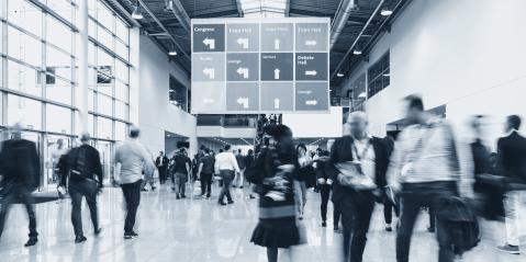 Anonymous blurred people walking in a hall of a Exhibition- Stock Photo or Stock Video of rcfotostock | RC-Photo-Stock