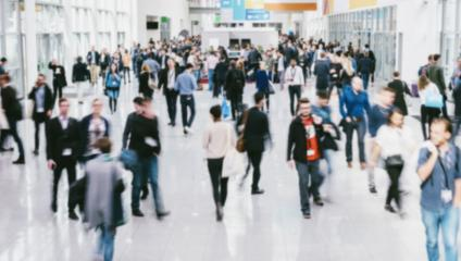 anonymous blurred people walking in a modern hall of a Exhibition- Stock Photo or Stock Video of rcfotostock | RC-Photo-Stock