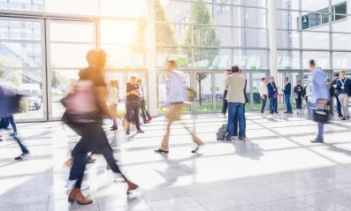 Anonymous business people hurry through trade fair hall - Stock Photo or Stock Video of rcfotostock   RC-Photo-Stock