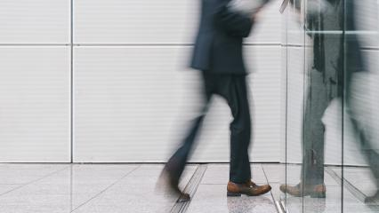 anonymous businessman walking in a corridor- Stock Photo or Stock Video of rcfotostock | RC-Photo-Stock