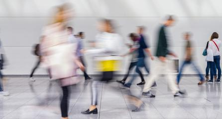 Anonymous crowd of business people go through aisle at a trade fair- Stock Photo or Stock Video of rcfotostock | RC-Photo-Stock