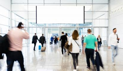 Anonymous crowd under a blank white advertising poster on trade fair- Stock Photo or Stock Video of rcfotostock | RC-Photo-Stock