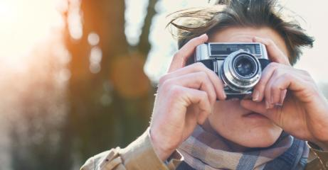 Attractive Tourist taking a photograph with vintage camera- Stock Photo or Stock Video of rcfotostock | RC-Photo-Stock