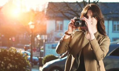 Attractive Tourist taking a photograph with vintage camera : Stock Photo or Stock Video Download rcfotostock photos, images and assets rcfotostock | RC-Photo-Stock.: