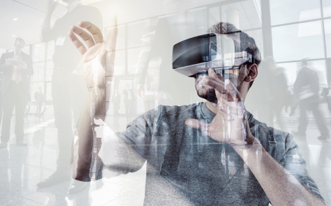 Attractive young man wearing virtual reality goggles/VR headset on a gaming exibition : Stock Photo or Stock Video Download rcfotostock photos, images and assets rcfotostock | RC-Photo-Stock.: