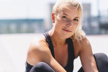 attractive young woman in sportswear enjoying Relaxing after training. Cheerful mood, true emotions, healthy lifestyle- Stock Photo or Stock Video of rcfotostock | RC-Photo-Stock