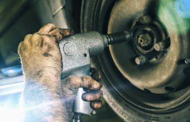 Auto mechanic changing a car tire in mechanics garage and using a electric drill to loosen the bolts. Repair service. authentic close-up shot - Stock Photo or Stock Video of rcfotostock | RC-Photo-Stock