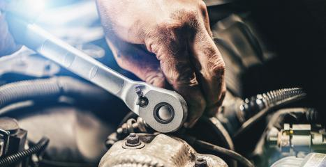 Auto mechanic hands working on car engine in mechanics garage. Repair service. authentic close-up shot- Stock Photo or Stock Video of rcfotostock | RC-Photo-Stock