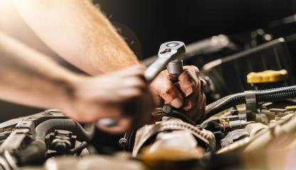 Auto mechanic in car repair service with wrench - Stock Photo or Stock Video of rcfotostock | RC-Photo-Stock