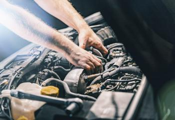 Auto mechanic repairing car- Stock Photo or Stock Video of rcfotostock | RC-Photo-Stock