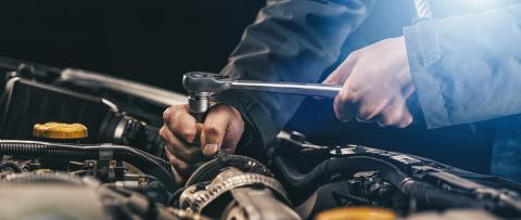 Auto mechanic working on car engine in mechanics garage. Repair service. authentic close-up shot, banner size- Stock Photo or Stock Video of rcfotostock | RC-Photo-Stock