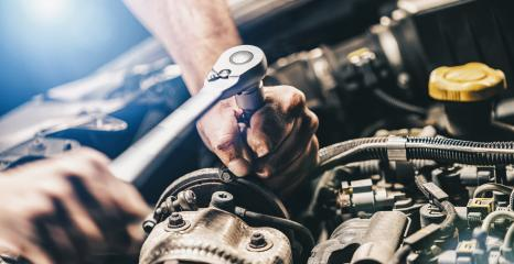 Auto mechanic working on car engine in mechanics garage. Repair service concept image. authentic close-up shot : Stock Photo or Stock Video Download rcfotostock photos, images and assets rcfotostock | RC-Photo-Stock.: