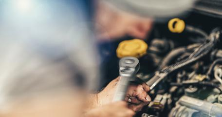 Auto mechanic working on car engine in mechanics garage. Repair service. authentic close-up shot- Stock Photo or Stock Video of rcfotostock | RC-Photo-Stock