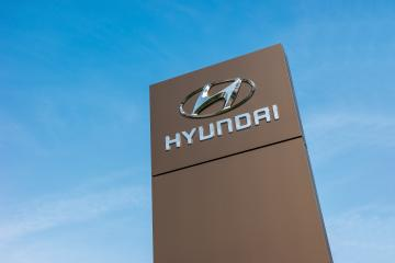 BAESWEILER, GERMANY MARCH, 2017: Logotype of Hyundai corporation on pillar against blue Sky.  Hyundai is the South Korea's automotive manufacturer.- Stock Photo or Stock Video of rcfotostock | RC-Photo-Stock