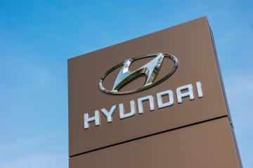 BAESWEILER, GERMANY MARCH, 2017: Logotype of Hyundai corporation on pillar over blue Sky.  Hyundai is the South Korea's automotive manufacturer. : Stock Photo or Stock Video Download rcfotostock photos, images and assets rcfotostock | RC-Photo-Stock.: