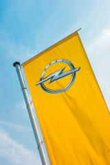 BAESWEILER, GERMANY MARCH, 2017: Opel flag closeup against blue sky at the Opel Store. Opel AG is a German automobile manufacturer.- Stock Photo or Stock Video of rcfotostock | RC-Photo-Stock