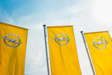 BAESWEILER, GERMANY MARCH, 2017: Opel flags against blue sky at the Opel Store. Opel AG is a German automobile manufacturer.- Stock Photo or Stock Video of rcfotostock   RC-Photo-Stock