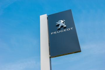 BAESWEILER, GERMANY MARCH, 2017: Peugeot dealership sign against blue sky. Peugeot is a French automobile manufacturer and part of Groupe PSA.- Stock Photo or Stock Video of rcfotostock | RC-Photo-Stock