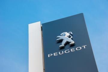 BAESWEILER, GERMANY MARCH, 2017: Peugeot dealership sign closeup against blue sky. Peugeot is a French automobile manufacturer and part of Groupe PSA.- Stock Photo or Stock Video of rcfotostock | RC-Photo-Stock