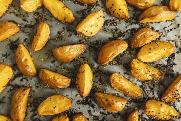 Baked potato wedges on baking tray : Stock Photo or Stock Video Download rcfotostock photos, images and assets rcfotostock   RC-Photo-Stock.: