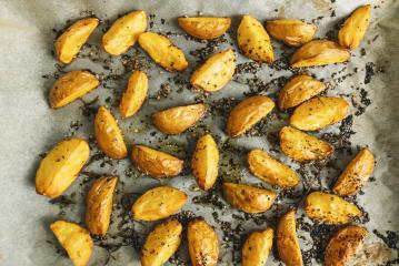 Baked potato wedges with rosemary and oil -  homemade organic vegetable vegan vegetarian potato wedges snack food meal.- Stock Photo or Stock Video of rcfotostock | RC-Photo-Stock