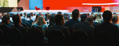 Banner cover page of Rear view of Audience listening Speakers on the stage in the conference hall or seminar meeting, business and education about investment concept- Stock Photo or Stock Video of rcfotostock | RC-Photo-Stock