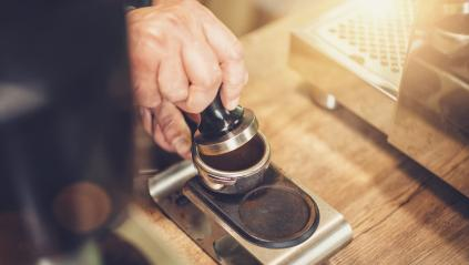 Barista making coffee, pressing temper on portafilter before brewing, at cafe- Stock Photo or Stock Video of rcfotostock | RC-Photo-Stock
