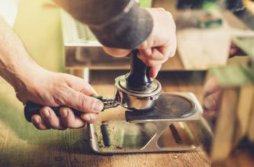Barista prepares espresso in his coffeeshop : Stock Photo or Stock Video Download rcfotostock photos, images and assets rcfotostock | RC-Photo-Stock.: