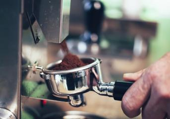 Barista preparing filter holder with coffee flour out of coffee beans mill.- Stock Photo or Stock Video of rcfotostock   RC-Photo-Stock