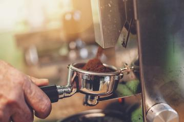 Barista preparing filter holder with coffee flour out of coffee beans mill- Stock Photo or Stock Video of rcfotostock | RC-Photo-Stock