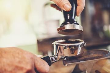 Barista presses ground coffee using tamper- Stock Photo or Stock Video of rcfotostock | RC-Photo-Stock
