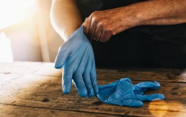 bartender or employee wearing a medical Latex gloves at work to prevent corona COVID-19 and SARS infection- Stock Photo or Stock Video of rcfotostock | RC-Photo-Stock