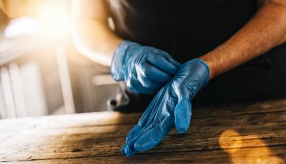 bartender or employee wearing a medical Latex gloves at work to prevent Coronavirus corona virus covid 19 infection.- Stock Photo or Stock Video of rcfotostock | RC-Photo-Stock