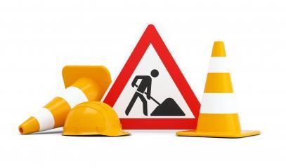 Baustelle, Baustellenschild mit Pylonen und Sicherheitshelm- Stock Photo or Stock Video of rcfotostock | RC-Photo-Stock