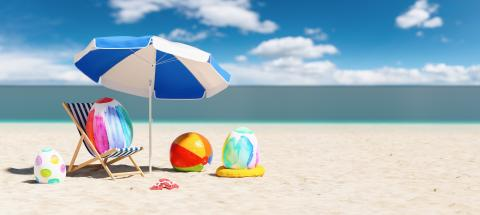 beach chair with colorful easter eggs flip-flop sandals next to a beach umbrella at the beach during a easter vacation in the Caribbean : Stock Photo or Stock Video Download rcfotostock photos, images and assets rcfotostock | RC-Photo-Stock.: