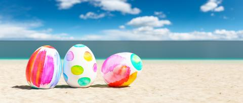 beach with colorful easter eggs during a easter vacation at the beach- Stock Photo or Stock Video of rcfotostock   RC-Photo-Stock