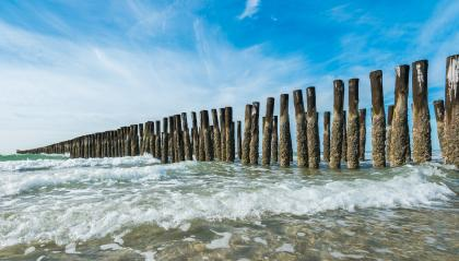 Beach with wooden wave breakers in the Seascape- Stock Photo or Stock Video of rcfotostock   RC-Photo-Stock