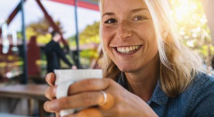 Beautiful smiling woman drinking coffee at cafe. Portrait of mature woman in a cafeteria drinking hot cappuccino and looking at camera. Pretty woman with cup of coffee.- Stock Photo or Stock Video of rcfotostock | RC-Photo-Stock