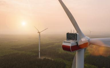 Beautiful sunset above the windmills on a fogy forest lanscape- Stock Photo or Stock Video of rcfotostock | RC-Photo-Stock