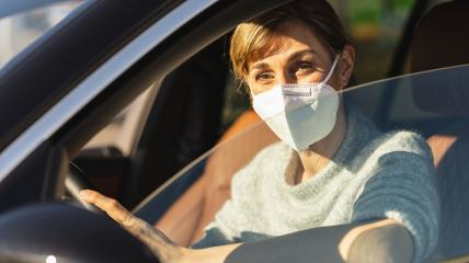 Beautiful woman with a N95 FFP2 anti virus mask sitting in a car, protective mask against coronavirus, driver on a city street during a coronavirus outbreak, covid-19.- Stock Photo or Stock Video of rcfotostock | RC-Photo-Stock