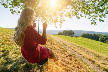 beautiful young woman on a swing on summer day outdoors - Stock Photo or Stock Video of rcfotostock | RC-Photo-Stock