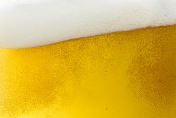 Beer foam wave with bubbles on golden Background- Stock Photo or Stock Video of rcfotostock | RC-Photo-Stock