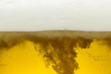Beer with bubbles on golden Background : Stock Photo or Stock Video Download rcfotostock photos, images and assets rcfotostock | RC-Photo-Stock.: