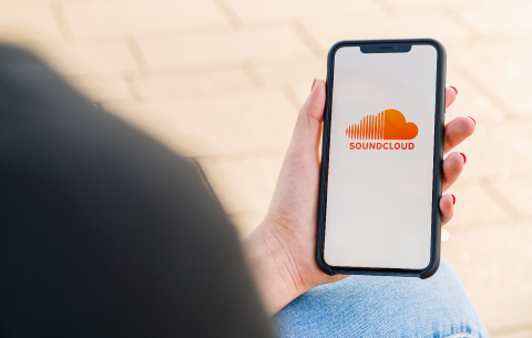 BERLIN, GERMANY AUGUST 2019: Woman hand holding iphone Xs opening soundcloud Music streaming app in the city. Streaming music via the Internet - Stock Photo or Stock Video of rcfotostock | RC-Photo-Stock