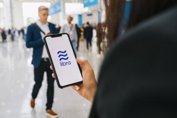 BERLIN, GERMANY AUGUST 2019: Woman hand holding iphone Xs with logo of Libra at a conference. Libra Facebook cryptocurrency and bitcoin cryptocurrency smartphone share, Libra coins concept.- Stock Photo or Stock Video of rcfotostock | RC-Photo-Stock