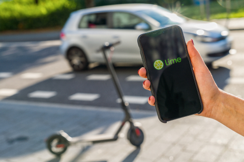 BERLIN, GERMANY AUGUST 2019: Woman hand holding iphone Xs with logo of LIME app displayed on a smartphone to rent a e-Scooter. Lime is a rental electric scooter company. Quick and easy way to travel : Stock Photo or Stock Video Download rcfotostock photos, images and assets rcfotostock | RC-Photo-Stock.: