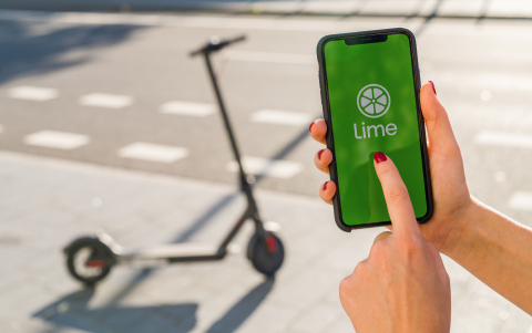BERLIN, GERMANY AUGUST 2019: Woman hand holding iphone Xs with logo of LIME app displayed on a smartphone to rent a e-Scooter. Lime is a rental electric scooter company. Quick and easy way to travel- Stock Photo or Stock Video of rcfotostock | RC-Photo-Stock