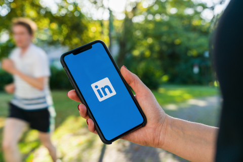 BERLIN, GERMANY AUGUST 2019: Woman hand holding iphone Xs with logo of LinkedIn application on the screen. LinkedIn is a business-oriented social networking service.- Stock Photo or Stock Video of rcfotostock | RC-Photo-Stock