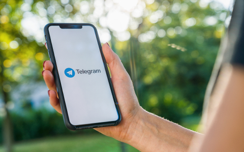 BERLIN, GERMANY AUGUST 2019: Woman hand holding iphone Xs with logo of Telegram application. Telegram app icon. Telegram is an online social media network. Social media app- Stock Photo or Stock Video of rcfotostock | RC-Photo-Stock